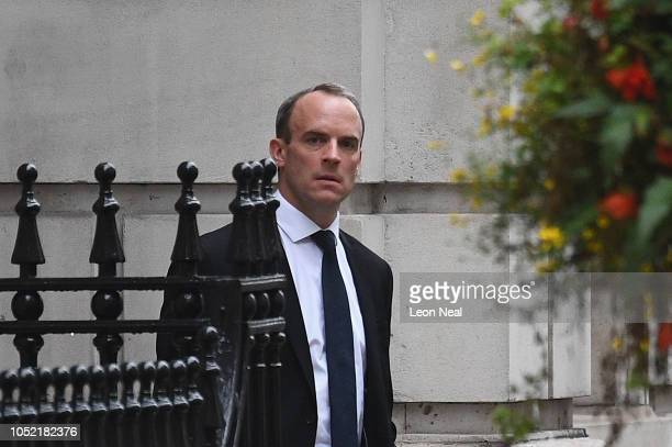 Secretary of State for Exiting the European Union Dominic Raab waits for his car as he leaves his office on October 15 2018 in London England Theresa...