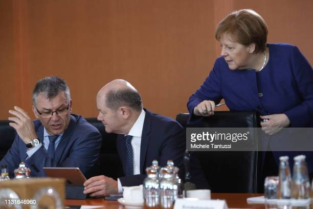 Secretary of state for finances Werner Gatzer German Finance Minister and vice Chancellor Olaf Scholz andGerman Chancellor Angela Merkel arrive for...