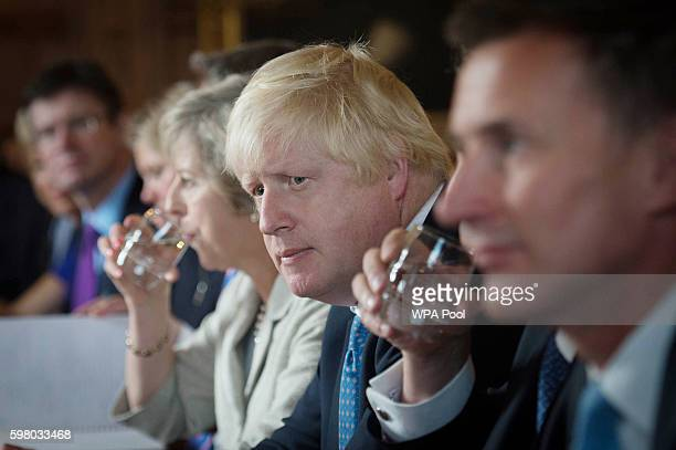 Secretary of State for Foreign and Commonwealth Affairs Boris Johnson listens during a cabinet meeting held by British Prime Minister Theresa May at...