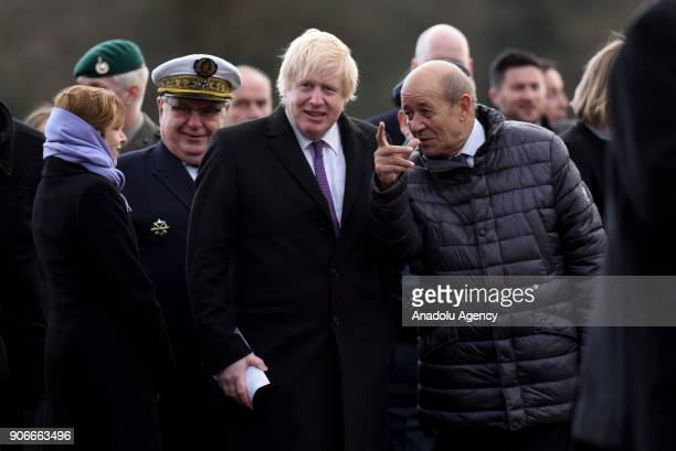 Secretary of State for Foreign and Commonwealth Affairs Boris Johnson waits for British Prime Minister Theresa May and French President Emmanuel...