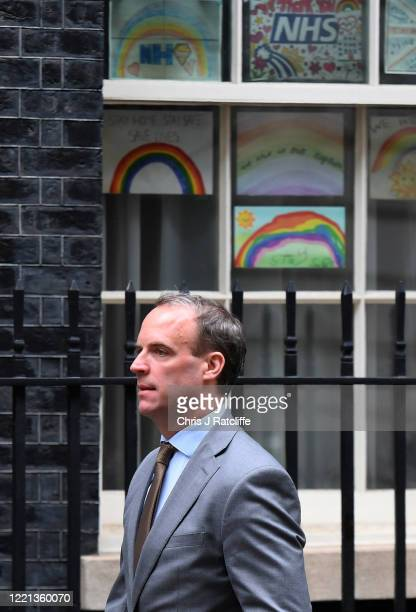 Secretary of State for Foreign and Commonwealth Affairs Dominic Raab departs from 10 Downing Street as Prime Minister Boris Johnson returns to work...