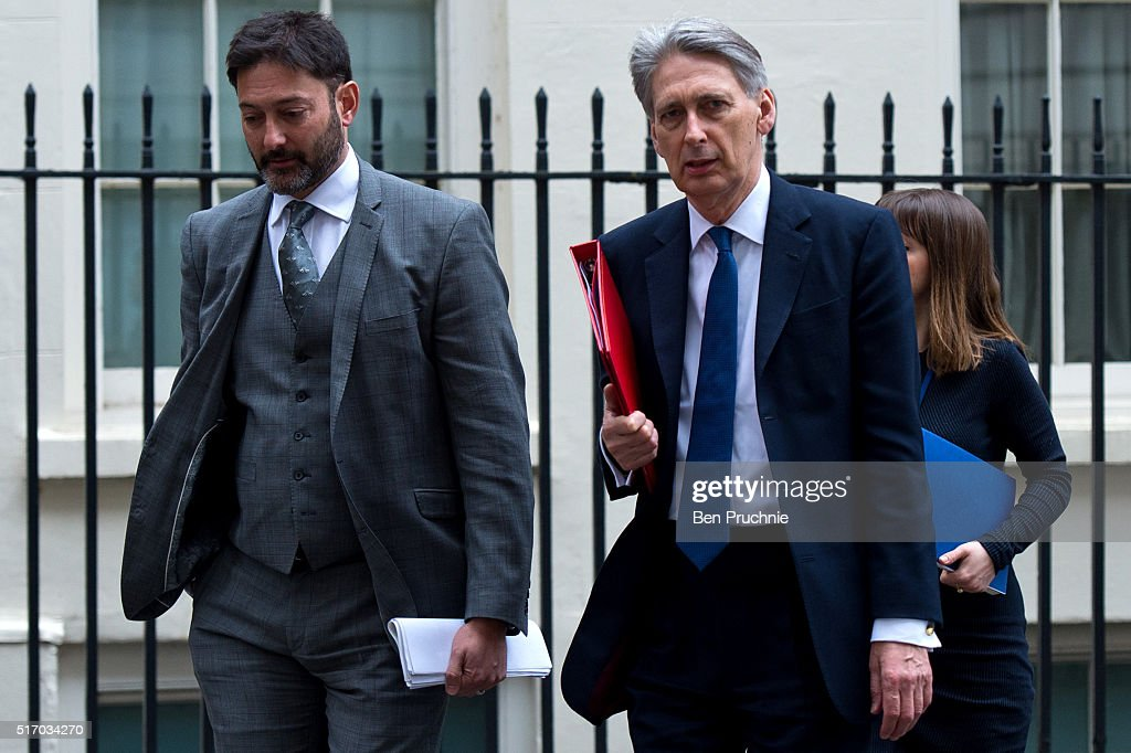 Secretary of State for Foreign and Commonwealth Affairs Philip Hammond (R) departs Number 10 Downing Street on March 23, 2016 in London, England. David Cameron chaired a second Cobra meeting today in the wake of yesterday's Brussels attacks in which 34 people were killed. He said that UK security had been stepped up in the wake of 'a very real terror threat' across Europe. Home Secretary Theresa May will make a statement to the House of Commons following Prime Minister's Questions.