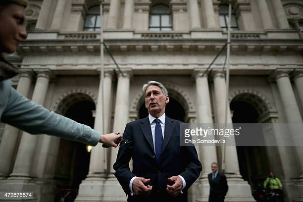 Secretary of State for Foreign and Commonwealth Affairs Philip Hammond makes brief remarks to the press after he arrives at the Foreign and...
