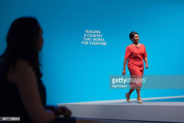 Secretary of State for International Development Priti Patel walks on stage to deliver her keynote speech on day three of the annual Conservative...