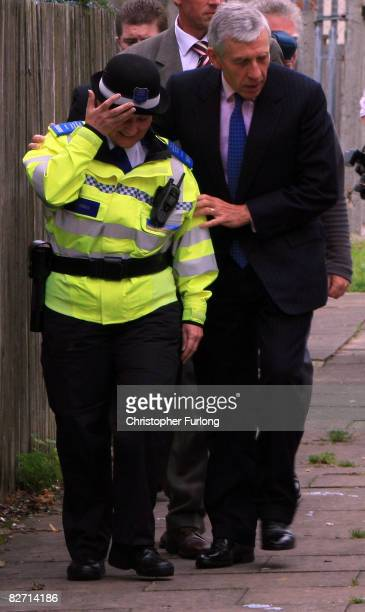 Secretary of State for Justice Jack Straw gives a helping hand to community police officer Suzanne Haskins after she was momentarily blinded by dust...