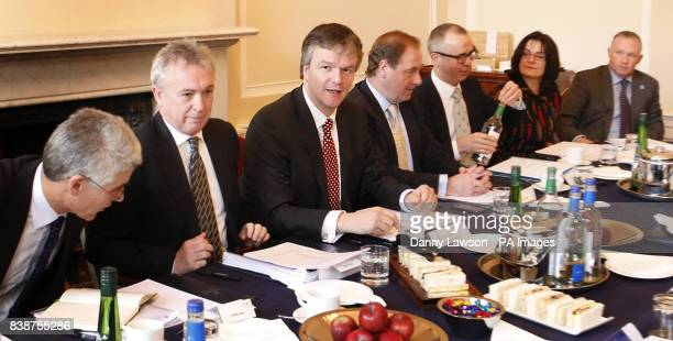 Secretary of State for Scotland Michael Moore is pictured with CBI Scotland members Gordon Grant Vice chair Glenn Allison Iain McMillan Gerry...