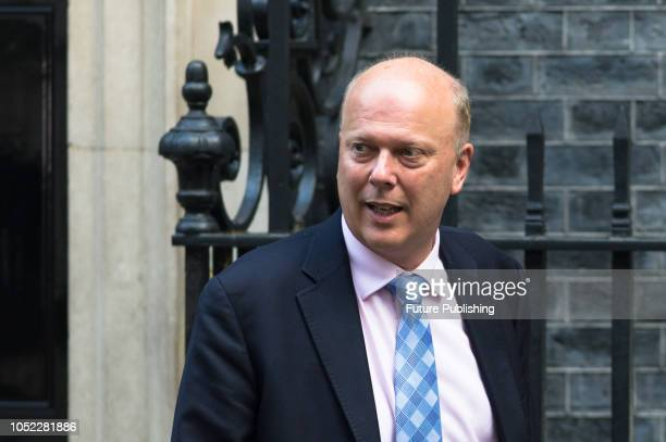 Secretary of State for Transport Chris Grayling leaves after a Cabinet meeting at 10 Downing Street in central London held to discuss the status of...