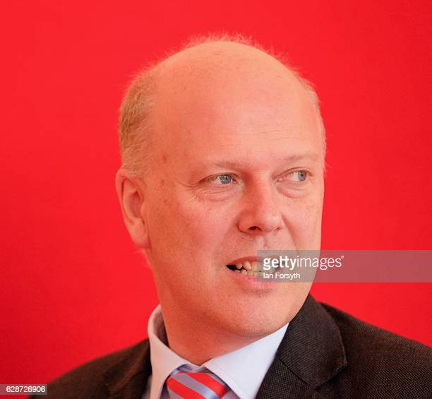 Secretary of State for Transport Chris Grayling MP speaks to guests as he visits the Hitachi Rail Europe site on December 9, 2016 in Newton Aycliffe,...