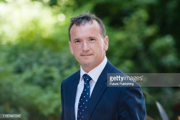 Secretary of State for Wales Alun Cairns arrives for Theresa May's final cabinet meeting as Prime Minister at 10 Downing Street on 23 July 2019 in...