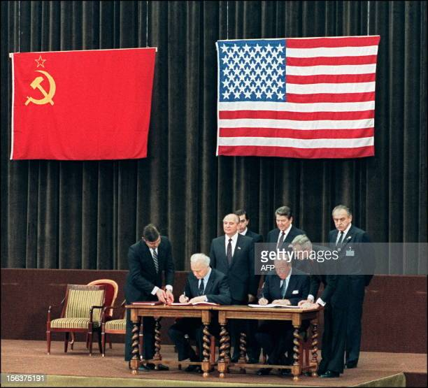 US Secretary of State George Schultz and his Soviet counterpart Eduard Shevardnadze shown in photo dated 21 November 1985 at the signing of a common...