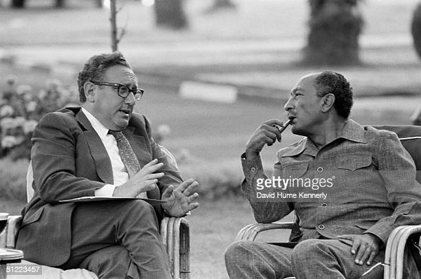 US Secretary of State Henry Kissinger and Egyptian President Anwar Sadat talk during the Sinai II negotiations which resulted in land being returned...