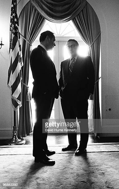Secretary of State Henry Kissinger and White House Chief of Staff Alexander Haig talk in the Cabinet Room at the White House six days after Gerald R...