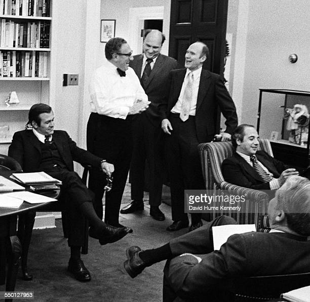 Secretary of State Henry Kissinger in his White House Office reacts to the news that the last Marines in Saigon had been evacuated, by helicopter,...