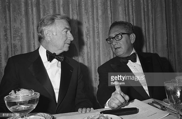 Secretary of State Henry Kissinger makes a point during chat with veteran CBSTV news broadcaster Walter Cronkite during a dinner in the latter's...