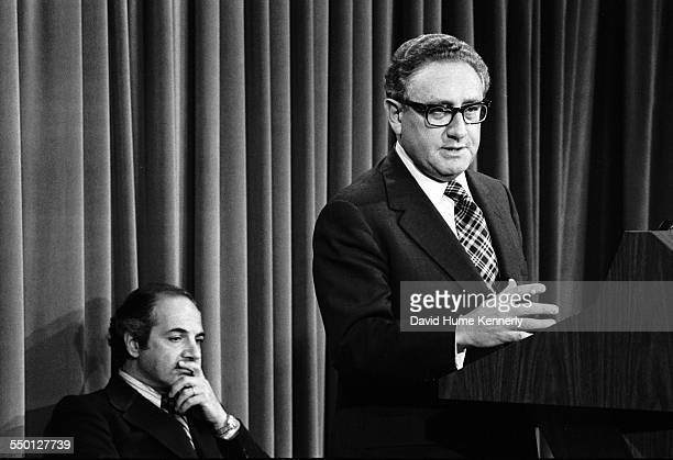 Secretary of State Henry Kissinger with White House Press Secretary behind him, announces the successful conclusion of the helicopter evacuation of...