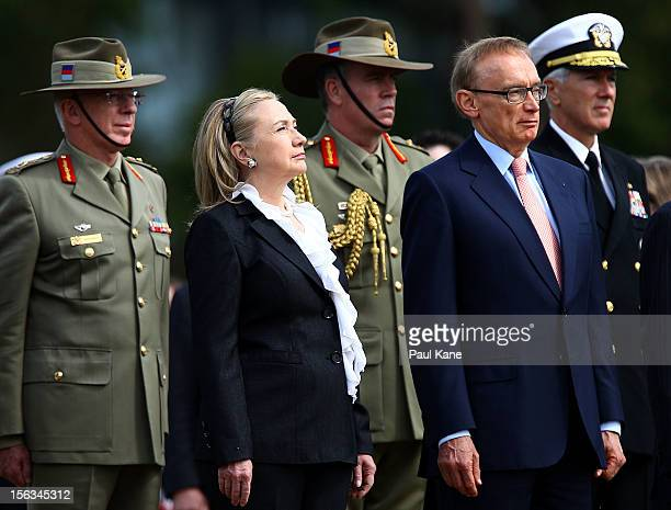 S Secretary of State Hillary Clinton and Australian Minister for Foreign Affairs Bob Carr stand to attention during wreath laying ceremony at Kings...