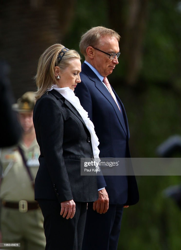 US Secretary of State Hillary Clinton and Australian Minister for Foreign Affairs Bob Carr stand to attention during awreath laying ceremony at Kings Park on November 14, 2012 in Perth, Australia. The bilateral AUSMIN forum will focus on foreign, defence and strategic policy and will be held in Perth today.