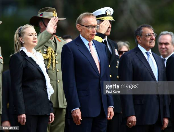 Secretary of State Hillary Clinton and Australian Minister for Foreign Affairs Bob Carr and US Secretary of Defense Leon Panetta stand to attention...