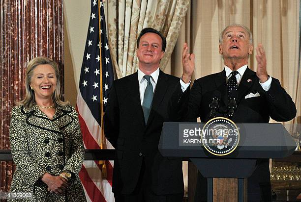 Secretary of State Hillary Clinton and British Prime Minister David Cameron look on during as Vice President Joe Biden looks towards the heavens...