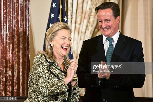 Secretary of State Hillary Clinton and British Prime Minister David Cameron share a laugh during a lunch hosted at the State Department on March 14...
