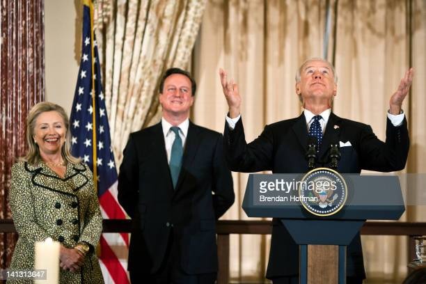 Secretary of State Hillary Clinton and British Prime Minister David Cameron laugh as Vice President Joe Biden makes a joke about asking his Irish...