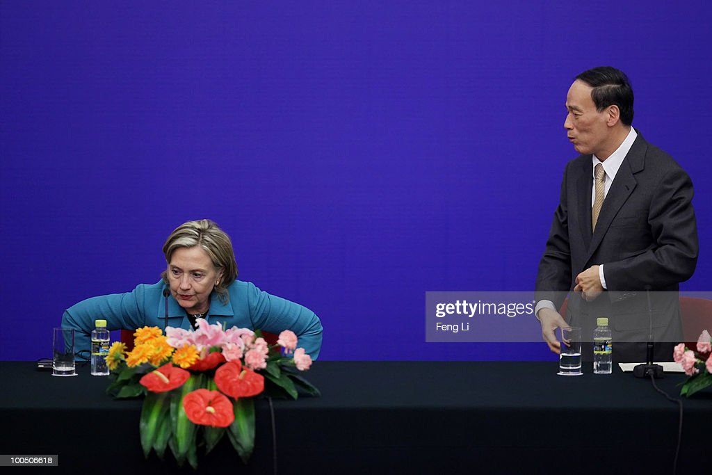 U.S. Secretary of State Hillary Clinton (L) and China's Vice Premier Wang Qishan stand up after a press conference for the China-U.S. Strategic and Economic Dialogue (S&ED) at the Great Hall of People on May 25, 2010 in Beijing, China. Hillary Clinton called upon Beijing to back international pressure against North Korea following the sinking of a South Korean warship, and to seek greater stability in the region.