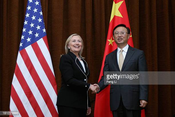 Secretary of State Hillary Clinton and Chinese Foreign Minister Yang Jiechi shake hands during her visit to Beijing on September 4, 2012.