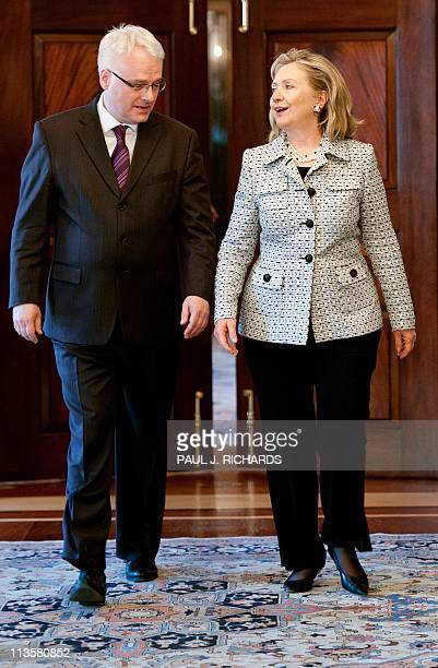 US Secretary of State Hillary Clinton and Croatian President Ivo Josipovic walk the hallways of the US Department of State on their way to delivering...
