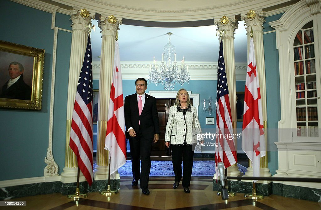 U.S. Secretary of State Hillary Clinton (R) and Georgian President Mikheil Saakashvili (L) enter a room to speak to members of the media after their meeting February 1, 2012 at the State Department in Washington, DC. President Saakashvili is on a state visit to Washington to mark the 20th anniversary of diplomatic relations between the United States and Georgia.