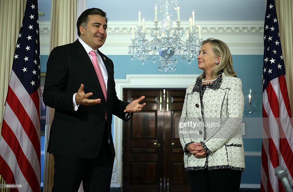 U.S. Secretary of State Hillary Clinton (R) and Georgian President Mikheil Saakashvili speak to members of the media after their meeting February 1, 2012 at the State Department in Washington, DC. President Saakashvili is on a state visit to Washington to mark the 20th anniversary of diplomatic relations between the United States and Georgia.