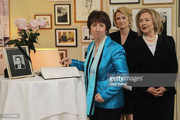 S Secretary of State Hillary Clinton and High Representative of the European Commission Lady Catherine Ashton sign a book of condolences as American...