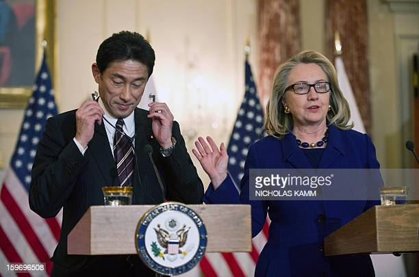 Secretary of State Hillary Clinton and Japanese Foreign Minister Fumio Kishida arrive to speak to the press following talks at the State Department...