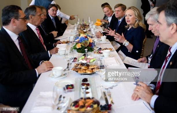US Secretary of State Hillary Clinton and Russian Foreign Minister Sergey Lavrov talk during a breakfast meeting after signing a Memorandum of...