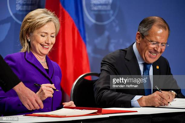 Secretary of State Hillary Clinton and Russian Foreign Minister Sergey Lavrov sign a plutonium disposition protocol at the Nuclear Security Summit on...