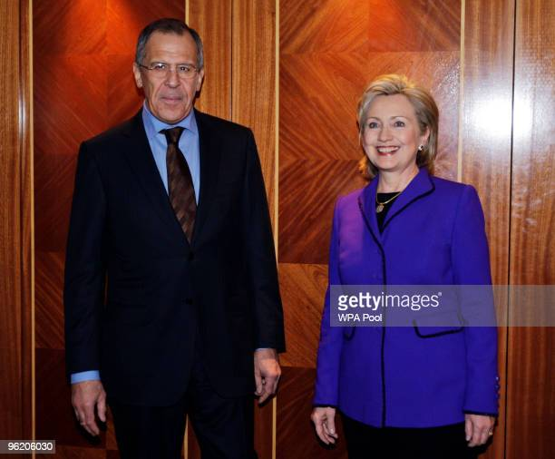 Secretary of State Hillary Clinton and Russian Foreign Minister Sergey Lavrov pose as they arrive for The Afghanistan Conference, on January 27, 2010...