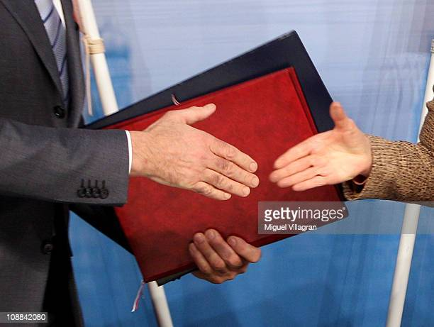 Secretary of State Hillary Clinton and Russian Foreign Minister Sergei Lavrov shake hands after exchanging documents formally bringing into force the...
