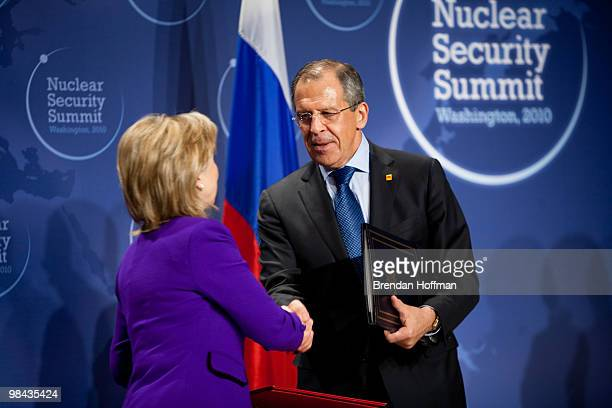 Secretary of State Hillary Clinton and Russian Foreign Minister Sergey Lavrov shake hands after signing a plutonium disposition protocol at the...