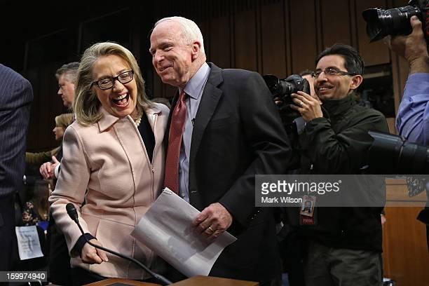 S Secretary of State Hillary Clinton and Sen John McCain joke and embrace before Sen John Kerry's confirmation hearing before the Senate Foreign...
