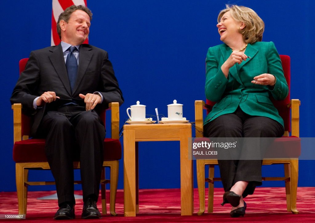 US Secretary of State Hillary Clinton and Treasury Secretary Timothy Geithner (L) laugh after Geithner spoke during the opening session of the second round of the US-China Strategic & Economic Dialogue at the Great Hall of the People in Beijing on May 24, 2010, during the start of the second round of the US-China Strategic & Economic Dialogue. The US and China opened two days of high-level talks due to cover a wide range of issues including tensions over the sinking of a South Korean warship, blamed on Pyongyang. AFP PHOTO / POOL / Saul LOEB
