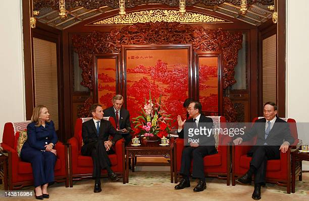 S Secretary of State Hillary Clinton and Treasury Secretary Timothy Geithner talk to China's Premier Wen Jiabao and Vice Premier Wang Qishan during a...