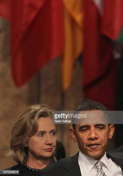 S Secretary of State Hillary Clinton and US President Barack Obama attend the Afghanistan roundtable meeting at the 2010 NATO Summit on November 20...