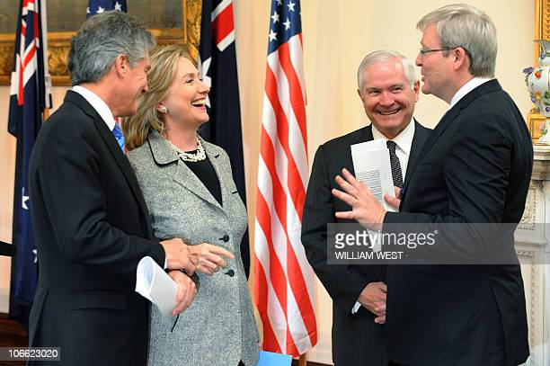 US Secretary of State Hillary Clinton and US Secretary of Defense Robert Gates share a moment with Australia's foreign minister Kevin Rudd and...