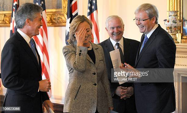 US Secretary of State Hillary Clinton and US Secretary of Defense Robert Gates share a moment with their Australian counterparts Foreign Minister...