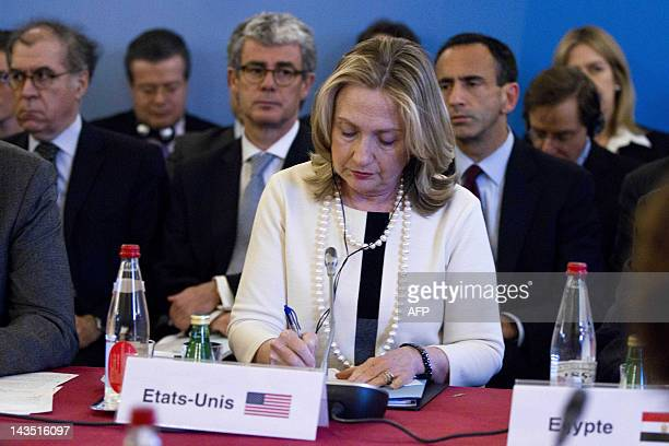 US Secretary of State Hillary Clinton attends a meeting at the French foreign ministry in Paris on April 19 as part of international efforts to end...