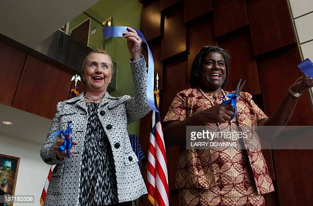 US Secretary of State Hillary Clinton attends on January 16 2012 a ribboncutting ceremony at the new US Embassy in Monrovia with US Ambassador to...