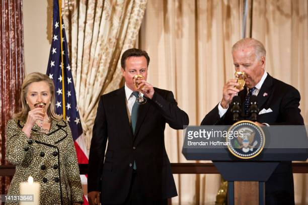 Secretary of State Hillary Clinton British Prime Minister David Cameron and Vice President Joe Biden share a toast during a lunch hosted at the State...