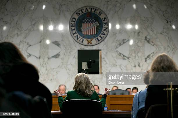 US Secretary of State Hillary Clinton center speaks during a Senate Foreign Relations Committee hearing in Washington DC US on Wednesday Jan 23 2013...