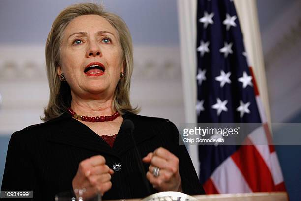 Secretary of State Hillary Clinton delivers a statement condemning the violence in Libya during a press conference in the Treaty Room at the...