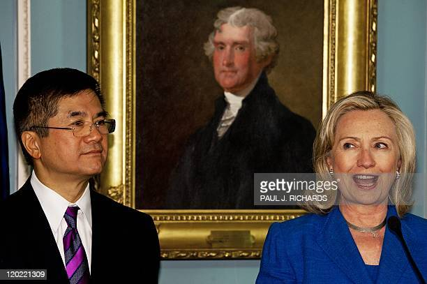 US Secretary of State Hillary Clinton delivers remarks as Gary Locke is present to be swornin as the first ChineseAmerican to serve as US ambassador...