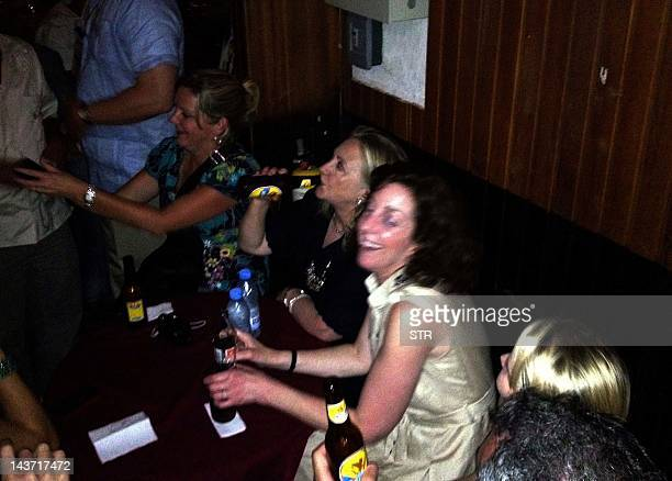 US Secretary of State Hillary Clinton enjoys a relax moment at Cafe Havana in Cartagena Colombia on April 15 2012 Clinton is in Cartagena to attend...